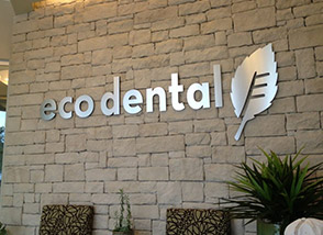 Eco Dental logo on office wall