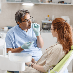Dentist talking to patient about tooth extractions