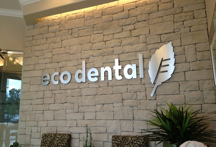 Eco Dental sign on office wall