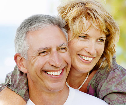 Older couple with happy healthy smiles