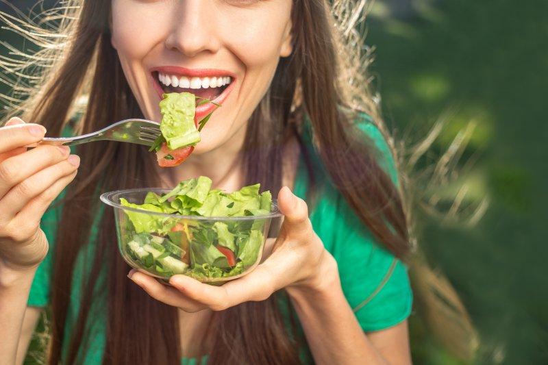 girl eating salad on vegan diet
