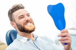Man at dentist for dental sealants